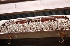 Decorazione di legno scolpita su una costruzione antica Fotografia Stock