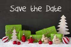 Decorazione di Natale, cemento, neve, risparmi inglesi del testo la data Fotografie Stock Libere da Diritti