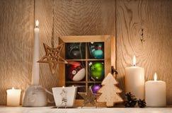 Decorazione di natale con le candele Fotografia Stock
