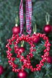 Decorazione di Natale - due cuori rossi Fotografia Stock Libera da Diritti