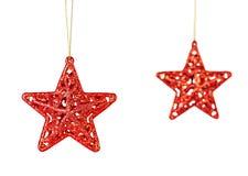 Decorazione di Natale. Stelle rosse isolate su fondo bianco. Fotografie Stock Libere da Diritti