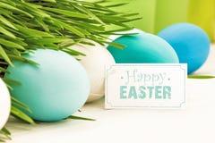 Decorazione di Pasqua con l'etichetta di saluto Fotografia Stock Libera da Diritti