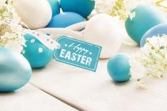 Decorazione di Pasqua con l'etichetta di saluto Fotografia Stock