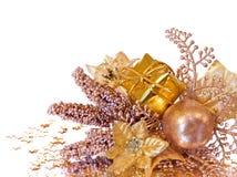 Decorazione dorata di natale - filiale del poinsettia Fotografia Stock