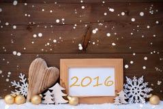Decorazione dorata di Natale, neve, 2016, fiocchi di neve Fotografie Stock