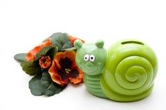 Decorazione floreale con il escargot della ceramica fotografia stock