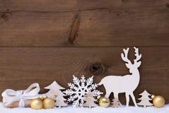 Decorazione, neve, albero, renna e regalo dorati di Natale Immagine Stock
