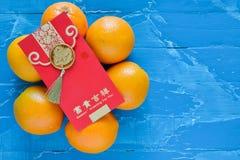 Decorazioni cinesi del nuovo anno arancio e busta rossa Fotografia Stock