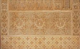 Decorazioni di moresco su una parete nel palalce di Nasrid, Alhambra, Granada Immagine Stock