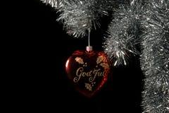 Decorazioni di Natale che appendono dallo scintillio Immagine Stock