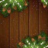 Decorazioni di Natale con neve su fondo di legno marrone Immagine Stock Libera da Diritti