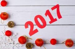 Decorazioni di Natale e l'iscrizione nel 2017 sull'sedere di legno Fotografia Stock