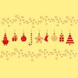 Decorazioni di Natale per il nuovo anno su un fondo giallo Immagine Stock