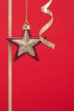 Decorazioni di natale rosse con la stella dell'oro Immagine Stock Libera da Diritti