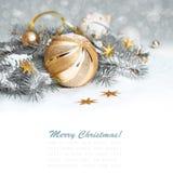 Decorazioni dorate di Natale, spazio del testo Fotografia Stock
