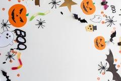Decorazioni e dolci della carta del partito di Halloween Immagine Stock Libera da Diritti