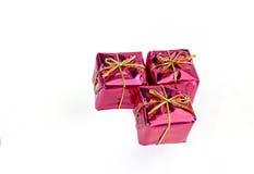 Decorazioni rosse di Natale del contenitore di regalo Fotografia Stock