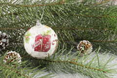 Decoupage Christmas ornament and fir tree on shiny background Royalty Free Stock Image