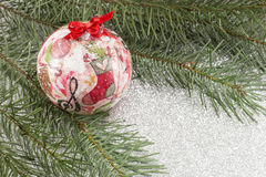 Decoupage Christmas ornament and fir tree on shiny background Stock Images