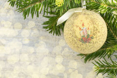 Decoupage Christmas ornament and fir tree on shiny background Stock Image