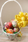 Decoupage decorated colorful Easter eggs in wicker basket Royalty Free Stock Photo