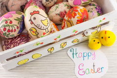 Decoupage decorated Easter eggs in decorated wooden box Royalty Free Stock Image