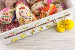 Decoupage decorated Easter eggs in decorated wooden box stock photography