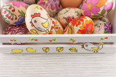 Decoupage decorated Easter eggs in decorated wooden box Royalty Free Stock Photography