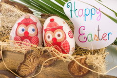 Decoupage decorated Easter eggs in old wagon Royalty Free Stock Images
