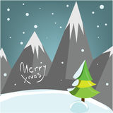 Decprative Christmas greeting card with mountains pine tree and snow. Royalty Free Stock Photo