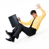 Decrease. Photo of confused man sliding down during financial crisis Stock Photo
