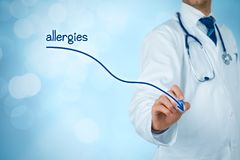 Decrease allergies. Concept. Doctor medical practitioner draw decreasing graph of allergies Stock Image