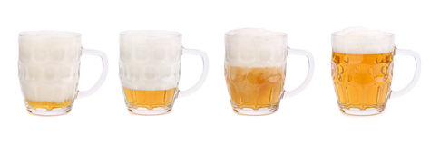 Decreasing the foam in a mug of beer Royalty Free Stock Photo