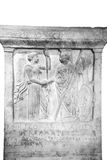 Decrees for Samos from Athenians. On the relief, the patron deities of the two cities. Athena and Hera respectively exchange a handshake as a show of their royalty free stock photos