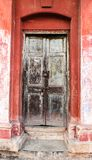 Decrepit door in an old house Royalty Free Stock Image