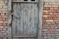 Decrepit and old door and brick wall in the evening Royalty Free Stock Photo