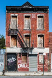 Decrepit old house in Queens (New York). Decrepit old house with red bricks and graffiti in Queens (New York Royalty Free Stock Image