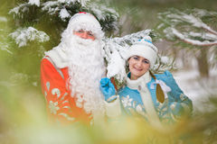 Ded Moroz (Father Frost) and Snegurochka (Snow Maiden) with gifts bag Royalty Free Stock Photos
