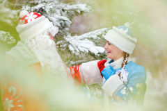 Ded Moroz (Father Frost) and Snegurochka (Snow Maiden) with gifts bag Stock Photos