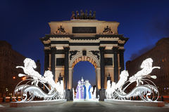 Ded Moroz and Snegurochka ride through the Triumphal Arch. Winter holiday light installation with Russian Ded Moroz Old Man Frost, the Russian Santa and his Royalty Free Stock Images