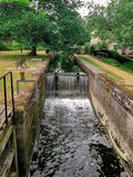 Dedham constable country green trees river waterfall essex calm bubbles grass bench ladder wall royalty free stock photography