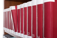 Dedicated book is of a bookshelf in the library. Stock Photos