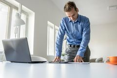Dedicated businessman standing working Stock Image