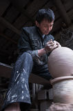 A dedicated Chinese potter. Was making a traditional pot  for wine in his workshop Royalty Free Stock Photography