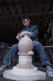 A dedicated Chinese potter. Was making a traditional pot  for wine in his workshop Royalty Free Stock Image