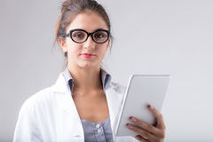 Dedicated doctor or nurse holding a tablet Royalty Free Stock Photography