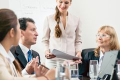 Dedicated manager sharing his opinion while interpreting a pie-c Stock Images