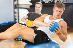 Dedicated men trains abdominal exercise for core strength Royalty Free Stock Photo