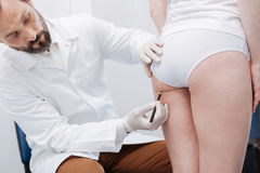 Dedicated plastic surgeon applying special techniques before the procedure Stock Photo