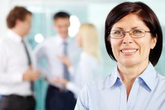Dedicated team member. Close-up portrait of a smiling mid-age business lady Royalty Free Stock Photography